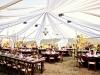 chandeliers-hanging-from-tent-outdoor-wedding-reception